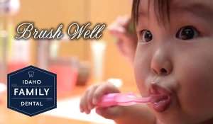 Child brushing their teeth the right way.